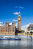 Big Ben and Houses of Parliament with boat in London, England, UK royalty free stock photos