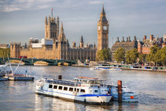 Big Ben and Houses of Parliament with boat in London, England, UK royalty free stock photography