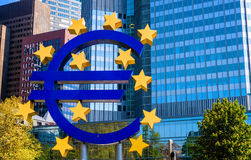 The Famous Big Euro Sign. FRANKFURT - MAY 5: The Famous Big Euro Sign at the European Central Bank on May 5, 2013 in Frankfurt, Germany. The bank was established royalty free stock photo