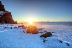 Famous Black beach in Iceland with beautiful sunrise light royalty free stock photo