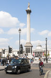 Famous black cab driving by Trafalgar Square Royalty Free Stock Image