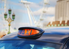 Famous black cab an a street in London Stock Photography