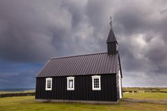 The famous black church of Budir in Iceland stock photos