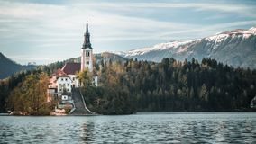 Lake Bled Church with warm glow royalty free stock photography