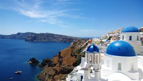The famous blue domes of the buildings in Oia on Santorini.  Stock Photo