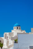 Famous blue domes on Santorini. A beautiful white church with blue dome against blue sky in Oia, Santorini island, Greece Royalty Free Stock Photography