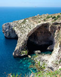 Famous Blue Grotto in Malta. Near Zurrieq on a calm sunny day. Vertical panorama from four horizontal frames Royalty Free Stock Photos