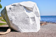Famous Boulder at White Rock beach, British Columbia, Canada. Famous boulder at the coastal city of White Rock, British Columbia, surrounding Semiahmoo Bay near Stock Image