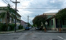 Famous Bourbon Street, New Orleans, Louisiana. Old houses in the French Quarter. City after the rain royalty free stock photos
