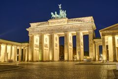 The famous Brandenburg Gate in Berlin. Illuminated at night royalty free stock photos
