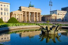 The famous Brandenburg Gate in Berlin. With reflections in a fountain stock photo