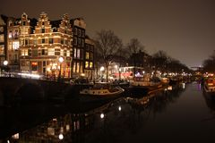 Famous bridge in amsterdam. romantic night landscape. a bit of haze and fog makes the magic channel royalty free stock photos