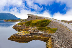 Famous bridge on the Atlantic road in Norway. Famous bridge through fjord on the Atlantic road in Norway - travel background royalty free stock photo