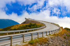 Famous bridge on the Atlantic road in Norway. Famous bridge through fjord on the Atlantic road in Norway - travel background Royalty Free Stock Images