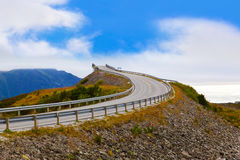 Famous bridge on the Atlantic road in Norway. Famous bridge through fjord on the Atlantic road in Norway - travel background royalty free stock image