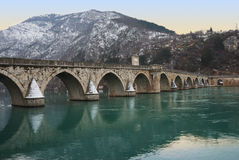 Famous Bridge on Drina. The bridge on the Drina in Visegrad in Bosnia and Herzegovina in twilight royalty free stock photos