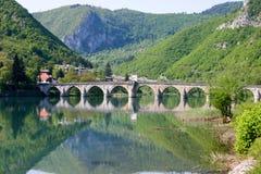 Famous bridge on drina river. Famous historic bridge on drina river, visegrad city, bosnia and herzegovina royalty free stock photos
