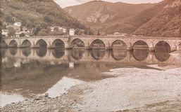 Famous bridge. Old fashion photo. Famous stone bridge on Drina river. Visegrad Bosnia and Herzegovina. Old fashion photo Royalty Free Stock Photos