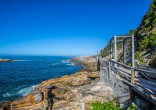 Famous bridge over Storms River Mouth at the Indian Ocean Stock Photos