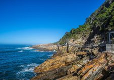 Famous bridge over Storms River Mouth at the Indian Ocean. In South Africa Stock Photography