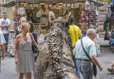 The famous bronze boar inside the Mercato del Porcellino in Florence, Italy. Florence, Italy, June 2015: the famous bronze boar inside the Mercato del Porcellino Stock Photos