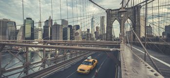 Famous Brooklyn Bridge with cab Stock Photos