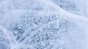 The famous bubbles in winter lake Baikal. Ice surface with small white bubbles. Unique pattern of nature.  stock photos