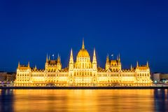 Famous Budapest parliament at the river Danube during blue hour Royalty Free Stock Photography