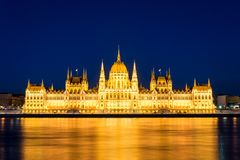 Famous Budapest parliament at the river Danube during blue hour Stock Photography
