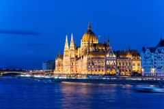 Famous Budapest parliament at the river Danube during blue hour Stock Photo
