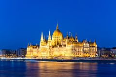 Famous Budapest parliament at the river Danube during blue hour Royalty Free Stock Photos