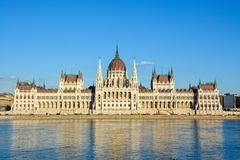 Famous Budapest parliament at the river Danube during sunset fro. The famous Budapest parliament at the river Danube during sunset from the front stock images