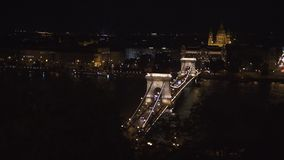 Famous building of Hungarian Parliament. Neogothic landmark in Budapest city at night. Magnificent aerial view stock footage