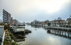 Famous buildings and place of Amsterdam city centre at cloudy day. AMSTERDAM, NETHERLANDS - DECEMBER 29, 2016: Famous buildings and place of Amsterdam city Stock Photo