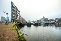 Famous buildings and place of Amsterdam city centre at cloudy day. AMSTERDAM, NETHERLANDS - DECEMBER 29, 2016: Famous buildings and place of Amsterdam city Stock Photography