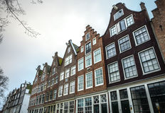Famous buildings and place of Amsterdam city centre at cloudy day. AMSTERDAM, NETHERLANDS - DECEMBER 29, 2016: Famous buildings and place of Amsterdam city Stock Images
