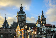 Famous buildings and place of Amsterdam city centre at sun set time. General landscape view. Stock Image