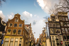 Famous buildings and place of Amsterdam city centre at sun set time. General landscape view. Stock Photo