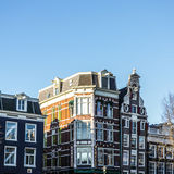 Famous buildings and place of Amsterdam city centre at sun set time. General landscape view. Stock Photos
