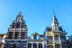Famous buildings and place of Amsterdam city centre at sun set time. General landscape view. Royalty Free Stock Image