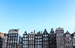 Famous buildings and place of Amsterdam city centre at sun set time. General landscape view. Stock Images
