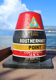 Famous Buoy sign marking the southernmost point in Continental United States in Key West, Florida. KEY WEST, FLORIDA - JUNE 1, 2016: Famous Buoy sign marking the Royalty Free Stock Images
