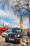 Famous cab at the Parliament square in London Stock Photography