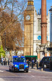 Famous cab an a street in London Royalty Free Stock Images