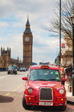 Famous cab on a street in London. LONDON - APRIL 5: Famous taxi cab (hackney) on a street on April 5, 2015 in London, UK. A hackney or hackney carriage (a cab Royalty Free Stock Photos
