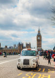 Famous cab on a street in London. LONDON - APRIL 5: Famous taxi cab (hackney) on a street on April 5, 2015 in London, UK. A hackney or hackney carriage (a cab Royalty Free Stock Image