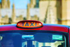 Famous cab on a street in London. LONDON - APRIL 12: Famous taxi cab (hackney) on a street on April 12, 2015 in London, UK. A hackney or hackney carriage (a cab Stock Images