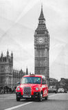 Famous cab on a street in London. LONDON - APRIL 5: Famous taxi cab (hackney) an a street on April 5, 2015 in London, UK. A hackney or hackney carriage (a cab Royalty Free Stock Photos