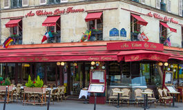 The famous cafe Au chien qui fume, Paris, France. Stock Images