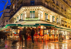 The famous cafe Les deux magots at night, Paris, France.
